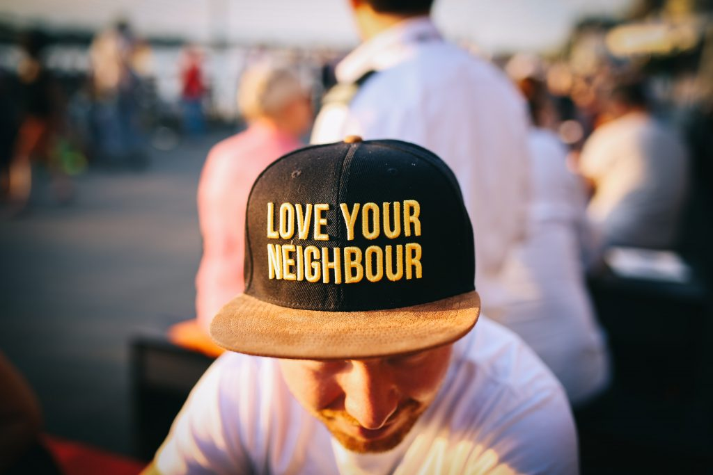 Man wearing cap that says Love your neighbor